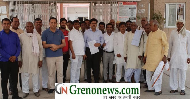 VILLAGERS GIVE MEMORANDUM TO DM FOR ROAD