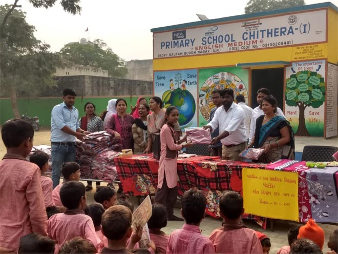 sweater distibutuin in primary school at greater noida